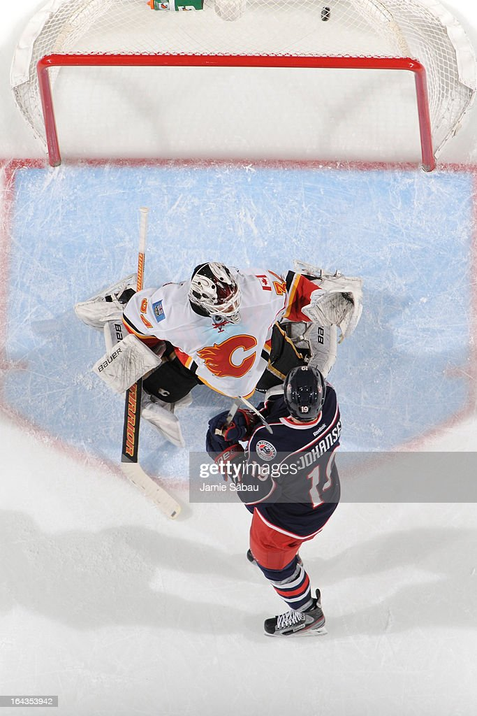The puck goes in the net off a shot from <a gi-track='captionPersonalityLinkClicked' href=/galleries/search?phrase=Nick+Foligno&family=editorial&specificpeople=537821 ng-click='$event.stopPropagation()'>Nick Foligno</a> #71 of the Columbus Blue Jackets as <a gi-track='captionPersonalityLinkClicked' href=/galleries/search?phrase=Ryan+Johansen&family=editorial&specificpeople=6698841 ng-click='$event.stopPropagation()'>Ryan Johansen</a> #19 of the Columbus Blue Jackets shields goaltender <a gi-track='captionPersonalityLinkClicked' href=/galleries/search?phrase=Miikka+Kiprusoff&family=editorial&specificpeople=171703 ng-click='$event.stopPropagation()'>Miikka Kiprusoff</a> #34 of the Calgary Flames during the second period on March 22, 2013 at Nationwide Arena in Columbus, Ohio.