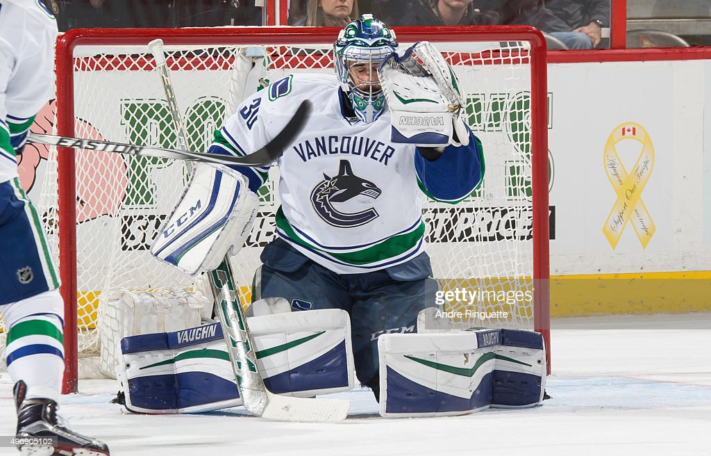 The puck goes through the glove of Ryan Miller of the Vancouver Canucks for a late third period goal by the Ottawa Senators at Canadian Tire Centre...