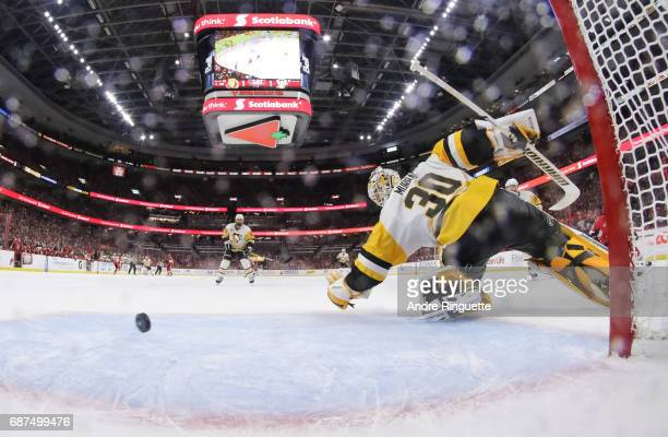 The puck goes wide of the net behind Matt Murray of the Pittsburgh Penguins on a shorthanded scoring chance by the Ottawa Senators in Game Six of the...