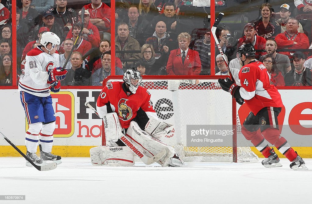 The puck hits <a gi-track='captionPersonalityLinkClicked' href=/galleries/search?phrase=Ben+Bishop&family=editorial&specificpeople=700137 ng-click='$event.stopPropagation()'>Ben Bishop</a> #30 of the Ottawa Senators in the crest during overtime as <a gi-track='captionPersonalityLinkClicked' href=/galleries/search?phrase=Raphael+Diaz&family=editorial&specificpeople=5333791 ng-click='$event.stopPropagation()'>Raphael Diaz</a> #61 of the Montreal Canadiens and Chris Phillips #4 of the Ottawa Senators look to control a rebound on February 25, 2013 at Scotiabank Place in Ottawa, Ontario, Canada.