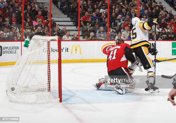 The puck hits the back of the net behind Craig Anderson the Ottawa Senators on a second period goal by Patric Hornqvist as Riley Sheahan of the...