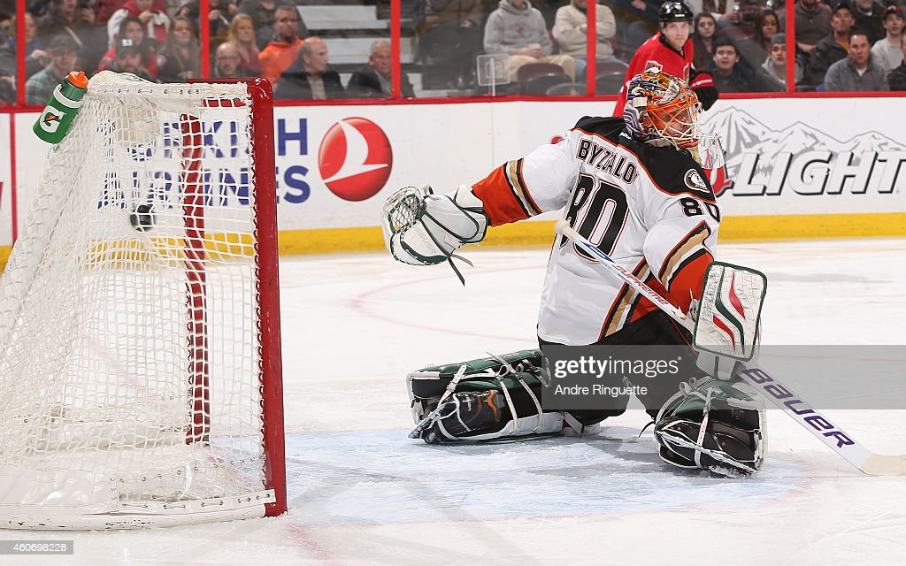 The puck hits the back of the net behind <a gi-track='captionPersonalityLinkClicked' href=/galleries/search?phrase=Ilya+Bryzgalov&family=editorial&specificpeople=2285430 ng-click='$event.stopPropagation()'>Ilya Bryzgalov</a> #80 of the Anaheim Ducks for the opening goal of an NHL game against the Ottawa Senators at Canadian Tire Centre on December 19, 2014 in Ottawa, Ontario, Canada.