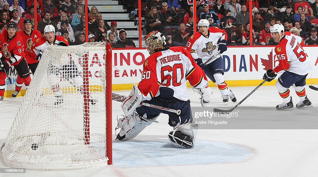 The puck hits the back of the net behind Jose Theodore #60 of the Florida Panthers on the first career NHL goal by Jakob Silfverberg of the Ottawa Senators (not pictured) as Dmitry Kulikov #7, <a gi-track='captionPersonalityLinkClicked' href=/galleries/search?phrase=Mike+Santorelli&family=editorial&specificpeople=4517042 ng-click='$event.stopPropagation()'>Mike Santorelli</a> #13 and <a gi-track='captionPersonalityLinkClicked' href=/galleries/search?phrase=Ed+Jovanovski&family=editorial&specificpeople=203147 ng-click='$event.stopPropagation()'>Ed Jovanovski</a> #55 of the Florida Panthers look on with <a gi-track='captionPersonalityLinkClicked' href=/galleries/search?phrase=Milan+Michalek&family=editorial&specificpeople=544987 ng-click='$event.stopPropagation()'>Milan Michalek</a> #9 and <a gi-track='captionPersonalityLinkClicked' href=/galleries/search?phrase=Jason+Spezza&family=editorial&specificpeople=202023 ng-click='$event.stopPropagation()'>Jason Spezza</a> #19 of the Ottawa Senators on January 21, 2013 at Scotiabank Place in Ottawa, Ontario, Canada.