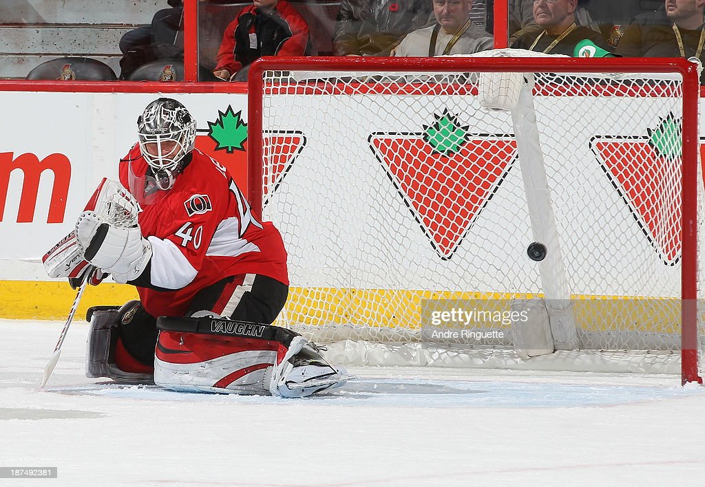 The puck hits the back of the net behind <a gi-track='captionPersonalityLinkClicked' href=/galleries/search?phrase=Robin+Lehner&family=editorial&specificpeople=5894610 ng-click='$event.stopPropagation()'>Robin Lehner</a> #40 of the Ottawa Senators for a third-period goal by the Florida Panthers at Canadian Tire Centre on November 9, 2013 in Ottawa, Ontario, Canada.