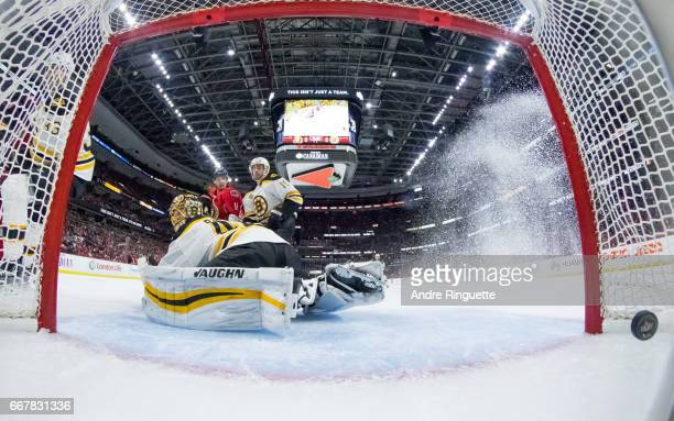 The puck hits the back of the net behind Tuukka Rask of the Boston Bruins for a second period goal by Bobby Ryan of the Ottawa Senators as Clarke...