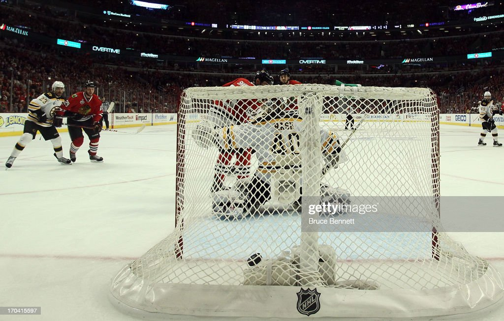 The puck hits the bakc of the net for the game-winning goal off of the stick of Andrew Shaw #65 in the third overtime against goalie Tuukka Rask #40 of the Boston Bruins in Game One of the 2013 NHL Stanley Cup Final at United Center on June 12, 2013 in Chicago, Illinois.
