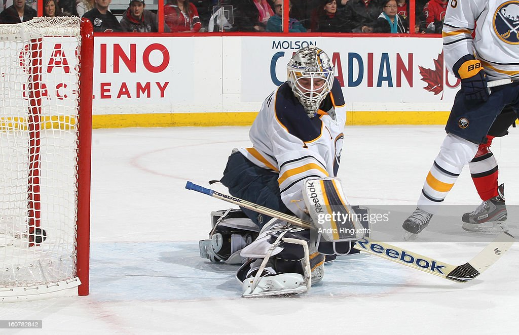 The puck hits the net behind Jhonas Enroth #1 of the Buffalo Sabres for a first period goal by the Ottawa Senators on February 5, 2013 at Scotiabank Place in Ottawa, Ontario, Canada.