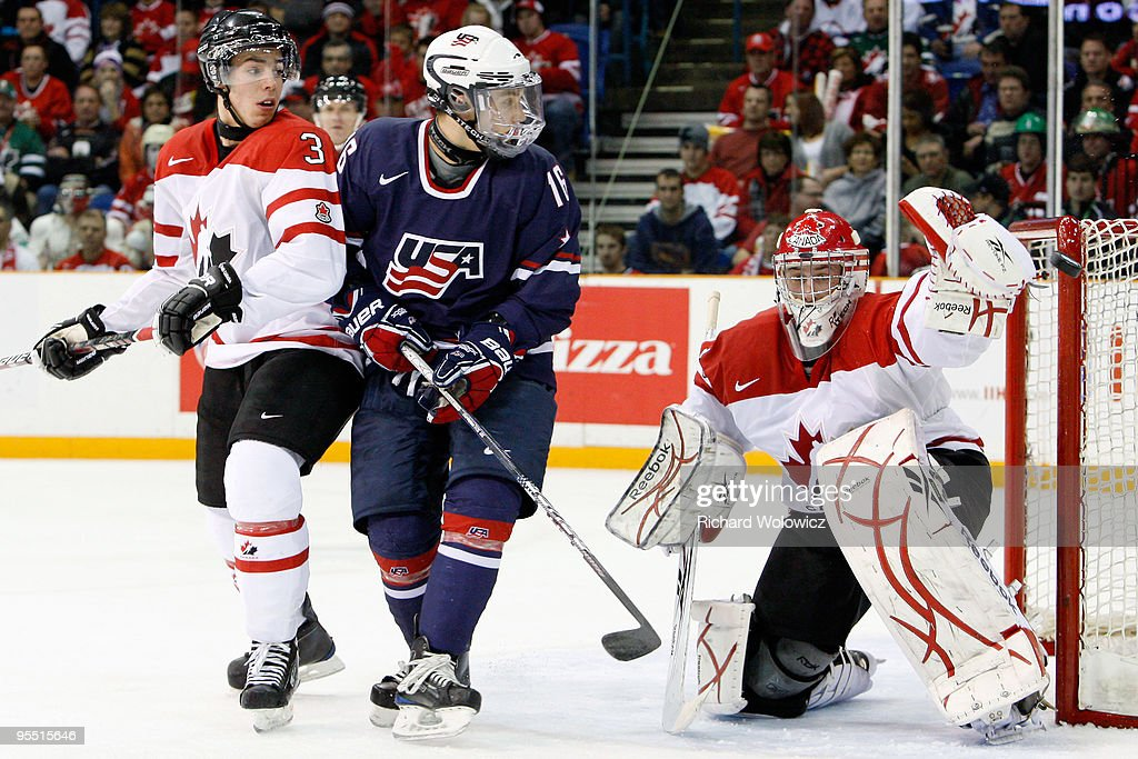The puck hits the post in front of Jake Allen #1 of Team Canada and Jason Zucker #16 of Team USA during the 2010 IIHF World Junior Championship Tournament game on December 31, 2009 at the Credit Union Centre in Saskatoon, Saskatchewan, Canada.