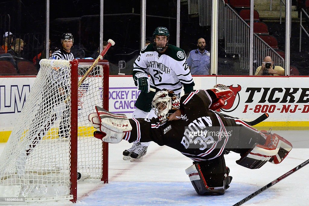 The puck is just out of reach of goalie Tyler Steel #35 of the Brown Bears as the Dartmouth Big Green score a goal at Prudential Center on October 26, 2013 in Newark, New Jersey. The Brown Bears defeated the Dartmouth Big Green, 5-3.