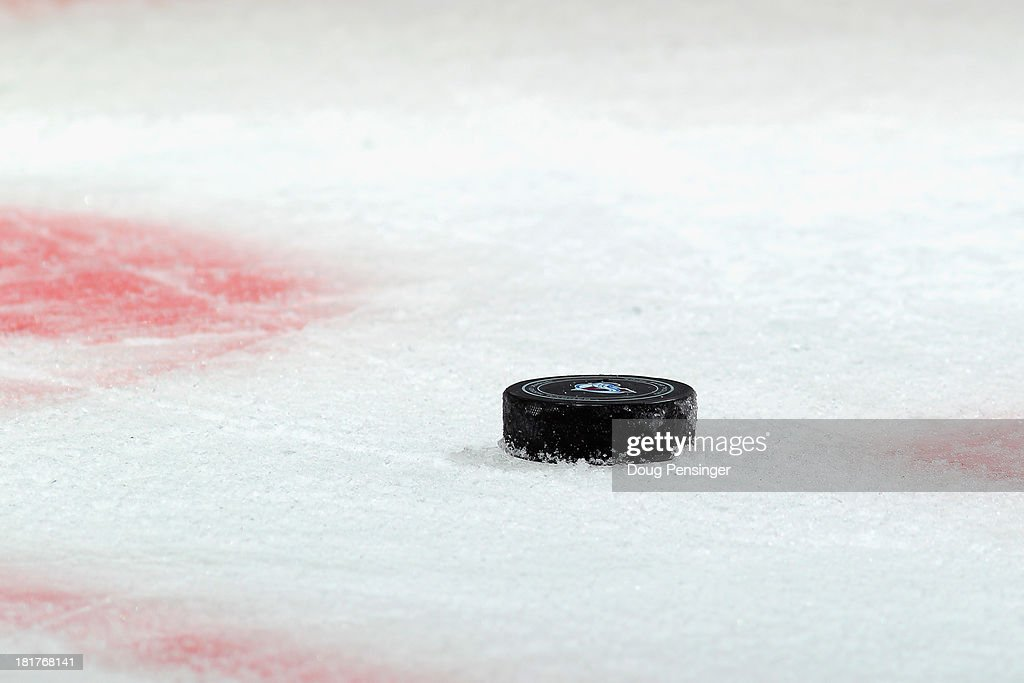The puck lays on the ice awaiting a face off between the Los Angeles Kings and the Colorado Avalanche during their preseason game at the Pepsi Center...