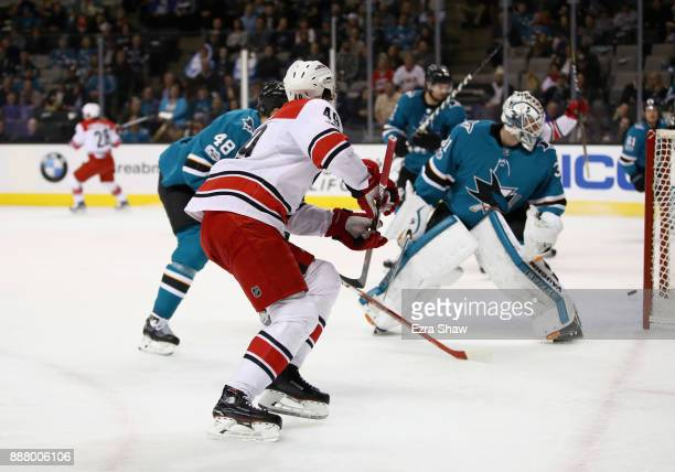 The puck pops back out from the net after Victor Rask of the Carolina Hurricanes scored on Martin Jones of the San Jose Sharks in the first period at...