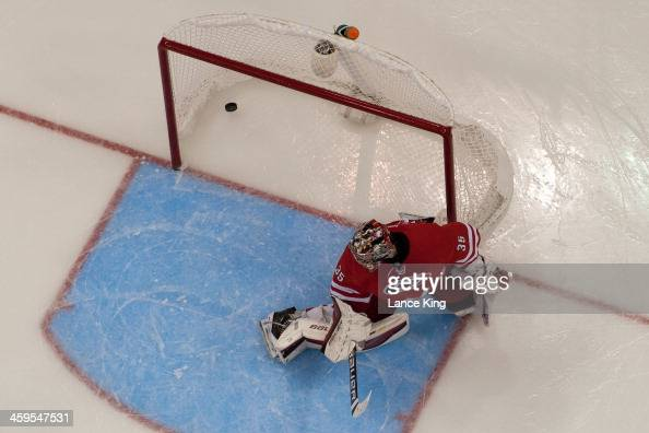 The puck shot by Sidney Crosby of the Pittsburgh Penguins gets past Justin Peters of the Carolina Hurricanes at PNC Arena on December 27 2013 in...