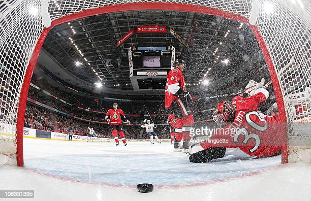 The puck sits just across the goal line behind Brian Elliott of the Ottawa Senators after the first career NHL goal by Paul Byron of the Buffalo...