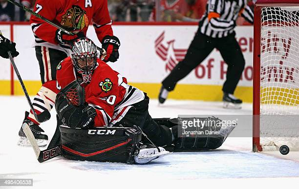 The puck slip past Corey Crawford of the Chicago Blackhawks on a goal by Anze Kopitar of the Los Angeles Kings in the first period at the United...
