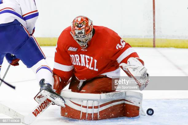 The puck slips behind Cornell Big Red goaltender Mitch Gillam during an NCAA Northeast Regional semifinal between the UMass Lowell River Hawks and...
