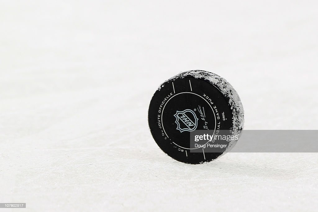 The puck stands on the ice during a break in the action between the Minnesota Wild and the Colorado Avalanche at the Pepsi Center on December 23 2010...