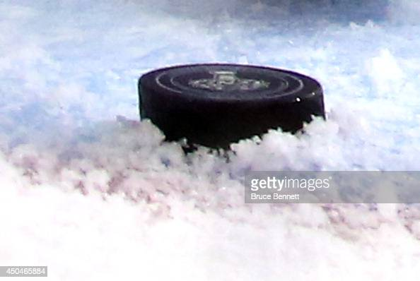 The puck stops just outside the goal behind Henrik Lundqvist of the New York Rangers after a play at the net during the third period of Game Four of...