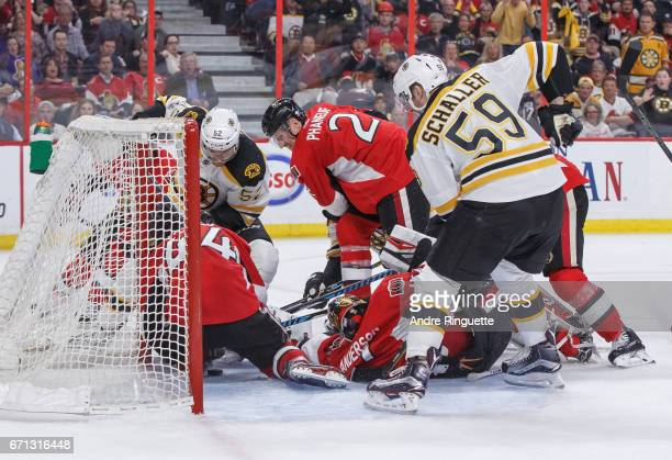 The puck stops short of the goal line during a scramble in the crease with JeanGabriel Pageau Dion Phaneuf and Craig Anderson of the Ottawa Senators...