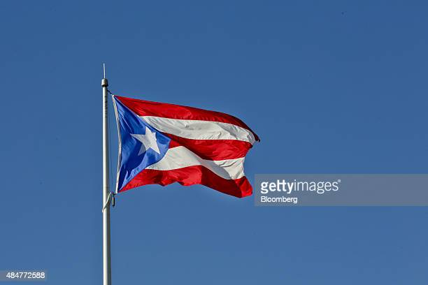 The Puerto Rican flag flies above the grounds of the Senate of Puerto Rico building in San Juan Puerto Rico on Friday Aug 14 2015 Puerto Rico bonds...