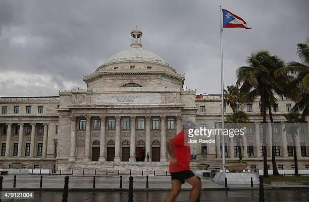 The Puerto Rican flag flies near the Capitol building as the island's residents deal with the government's $72 billion debt on July 1 2015 in San...
