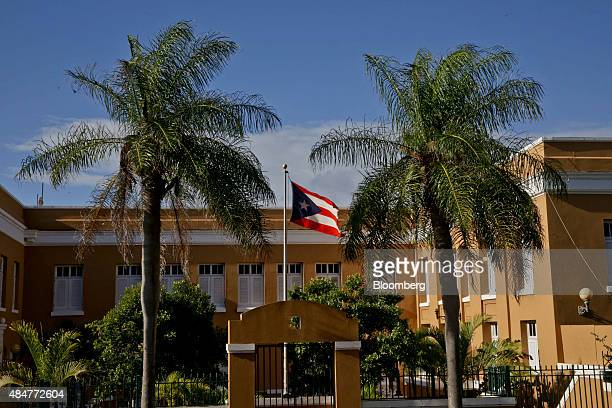 The Puerto Rican flag flies outside a building in Old San Juan Puerto Rico on Friday August 14 2015 Puerto Rico bonds may become attractive after the...