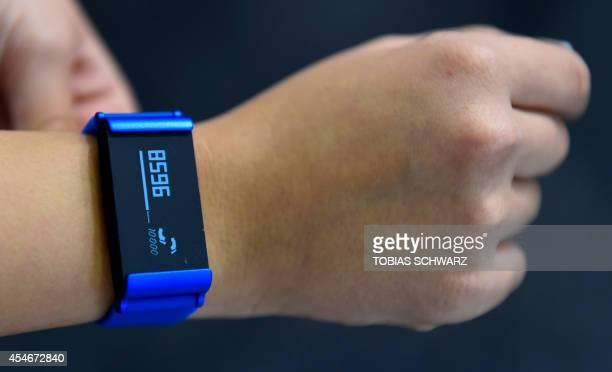 The Pulse O2 health wristband an activity tracker is displayed at the booth of French consumer electronics company Withings on the opening day of the...