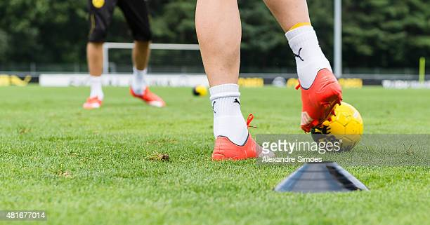 The Puma football boots of of Marco Reus of Borussia Dortmund playing with a small children's ball during a training session ot the training ground...