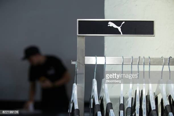 The puma logo sits above a clothing rack inside a Puma SE sportswear clothing store in Berlin Germany on Tuesday July 25 2017 Puma increased its...