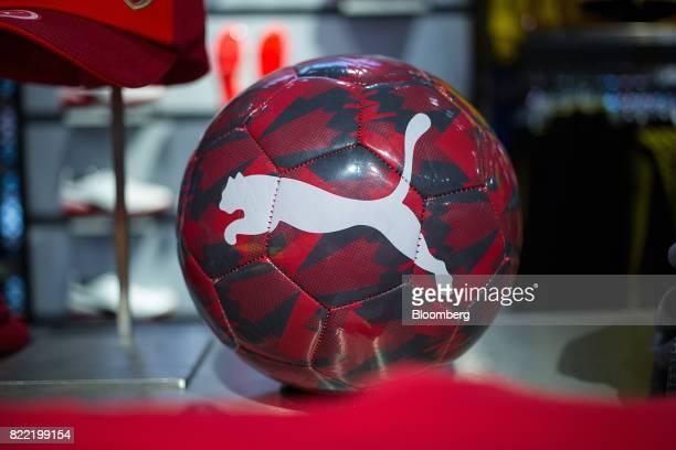 The Puma logo sits on a Arsenal English Premier League soccer club merchandise football inside a Puma SE sportswear clothing store in Berlin Germany...