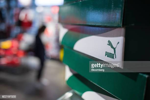 The Puma logo sits on shoe boxes inside a Puma SE sportswear clothing store in Berlin Germany on Tuesday July 25 2017 Puma increased its fullyear...