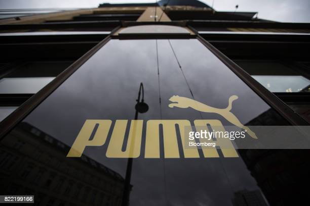 The Puma logo sits on the exterior of a Puma SE sportswear clothing store in Berlin Germany on Tuesday July 25 2017 Puma increased its fullyear...