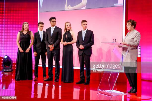 The pupils award winners Amelie Ernst Simon Roedel Reshad Quarizida Denise Conka Sebastian Kral and german politician Brigitte Zypries during the...