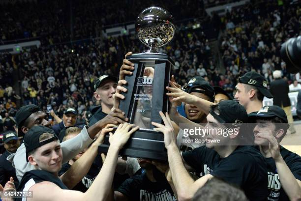 The Purdue Boilermakers hold up the Big Ten Championship trophy after winng their rivalry game over the Indiana Hoosiers on February 28 at Mackey...