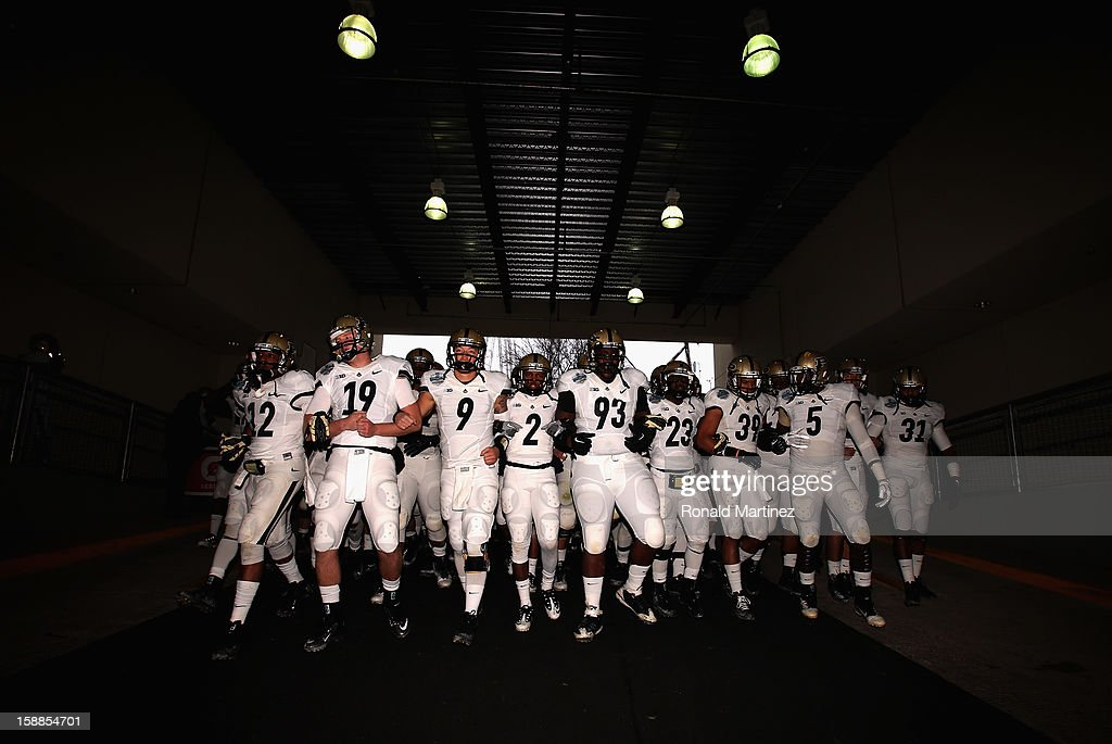 The Purdue Boilermakers walk to the field before play against the Oklahoma State Cowboys during the Heart of Dallas Bowl at Cotton Bowl on January 1...