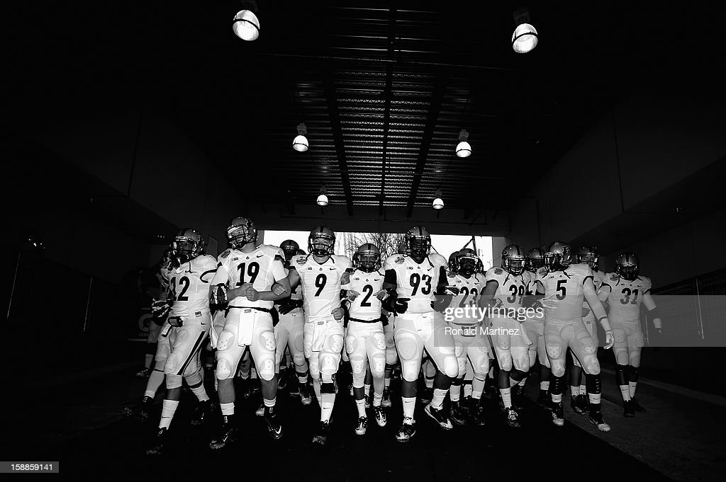 The Purdue Boilermakers walk to the field before play against the Oklahoma State Cowboys during the Heart of Dallas Bowl at Cotton Bowl on January 1, 2013 in Dallas, Texas.