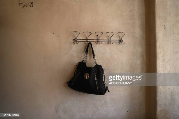 The purse of Syrian Umm Ahmad a seventythreeyear old widow who was displaced from the alMaliha area due to the ongoing fighting is seen inside her...