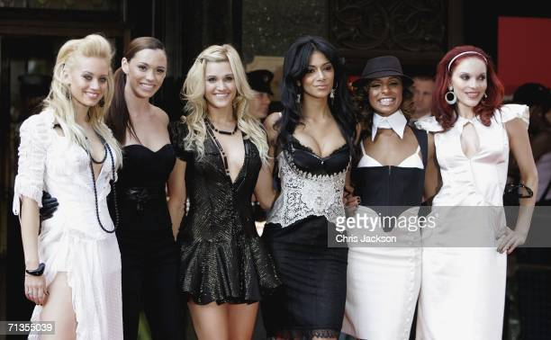 The Pussy Cat Dolls Kimberly Wyatt Jessica Sutta Ashley Roberts Nicole Scherzinger Melody Thorton and Carmit Bachar pose for a photograph as they...