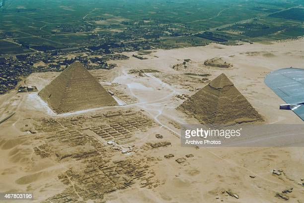 The pyramids of the Giza Necropolis in Egypt as seen from an aircraft circa 1960 On the left the Pyramid of Khufu and on the right the Pyramid of...
