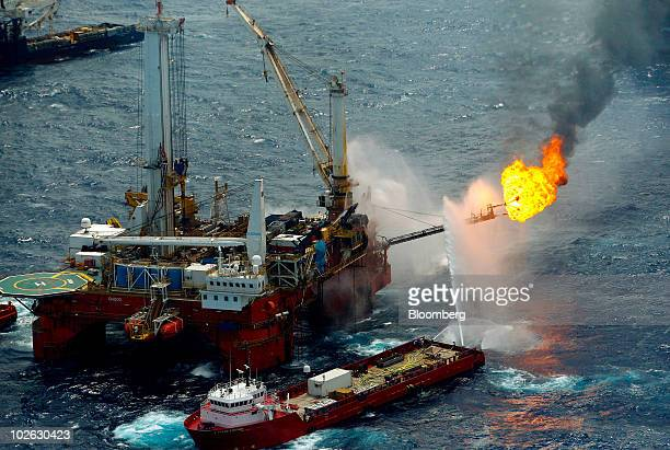 The Q4000 vessel burns off the oil and gas it collects at the site of the BP Plc Deepwater Horizon oil spill in the Gulf of Mexico off the coast of...