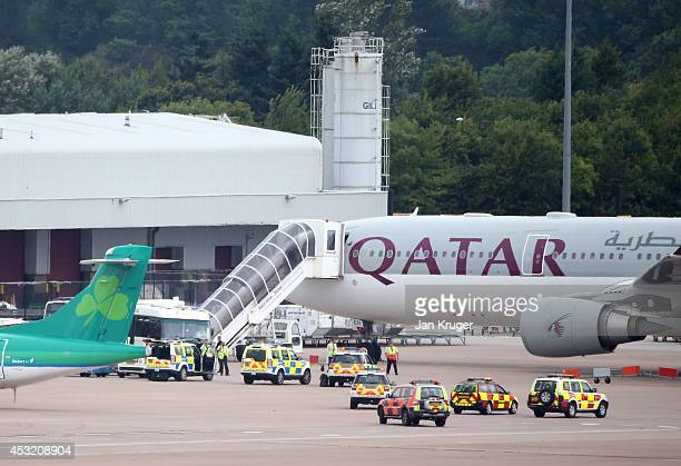 The Qatar Airways flight from Doha sits on the tarmac after having a military escort into Manchester Airport a man has been arrested on suspicion of...