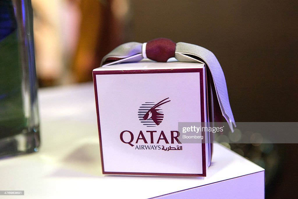 The Qatar Airways Ltd. logo sits on a gift box during the ITB travel fair at Messe Berlin exhibition center in Berlin, Germany, on Thursday, March 6, 2014. Al Baker said yesterday his company will be sticking with hard-wired inflight-entertainment systems. Photographer: Krisztian Bocsi/Bloomberg via Getty Images