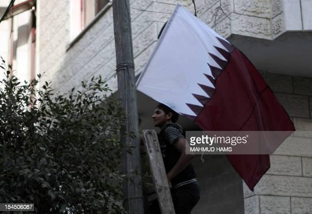 The Qatari flag is attached to a lamp post along a main street in Gaza City on October 21 the day before the Emir of Qatar's official visit to the...