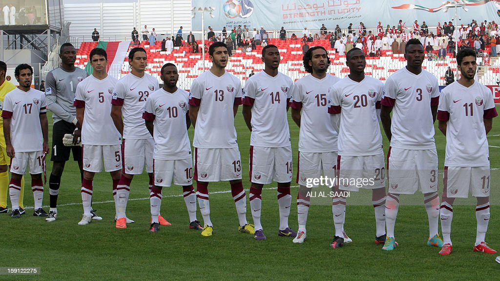 The Qatari team line up prior the start of their game against Oman in the 21st Gulf Cup in Manama, on January 8, 2013. AFP PHOTO/ALI AL-SAADI