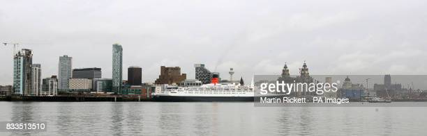 The QE2 sits docked on the River Mersey in Liverpool today as part of the famous Cunard liner's 40th anniversary UK tour