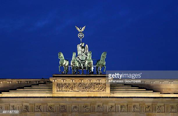 The quadriga at The Brandenburg Gate on January 31 2014 in Berlin GermanyThe Brandenburg Gate is a former city gate rebuilt in the late 18th century...