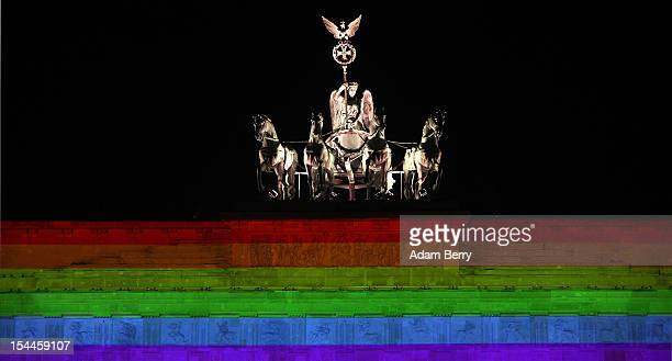 The Quadriga is seen atop the Brandenburg Gate with a rainbow projection during the Festival of Lights on October 20 2012 in Berlin Germany The...