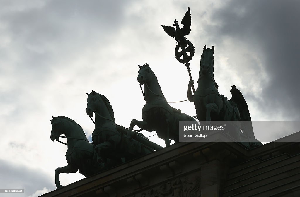 The Quadriga statue stands on top of the Brandenburg Gate silhouetted against dark clouds on September 19, 2013 in Berlin, Germany. Germany faces federal elections on September 22 and so far the German Christian Democrats (CDU) have a strong lead in polls over the German Social Democrats (SPD), their biggest rival, and other members of the opposition, though the election outcome could possibly force the two parties to form a coalition government.