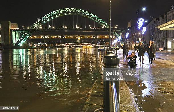 The Quayside shows signs of flooding as the River Tyne begins to burst its banks on December 05 2013 in Newcastle upon Tyne England The Environment...
