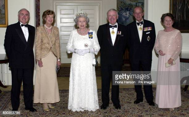 The Queen accompanied by the Duke of Edinburgh stands with from left Australian Prime Minister John Howard Lady Deane wife of Sir William Deane the...