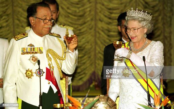 The Queen amd the Agong of Malaysia drink a toast at the state banquet at the Agong's palace Istana Negara Kuala Lumpur